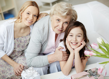 elderly woman with two daughters